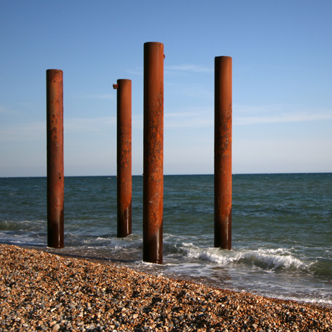 (ENGLAND, Brighton) The pilings looked lonely that day too. (Photo taken by the author.)